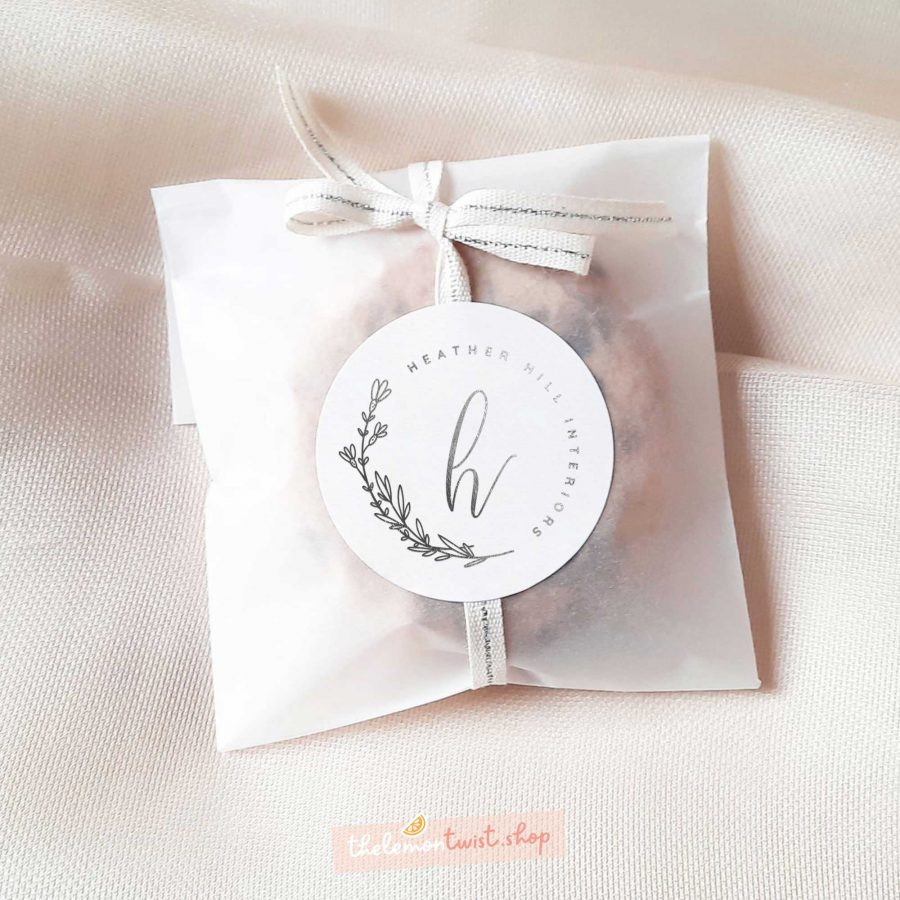 custom logo stickers with silver foil and white background
