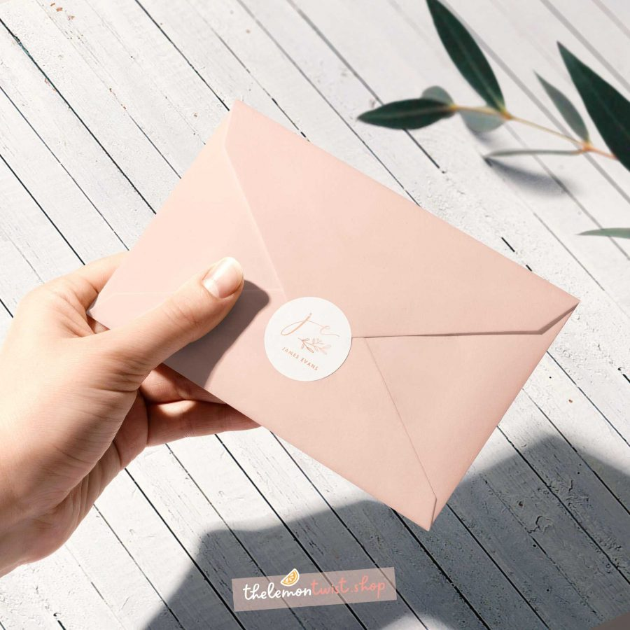 custom logo stickers with rose gold foil and white background